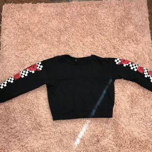 A black and red and white Long sleeve shirt